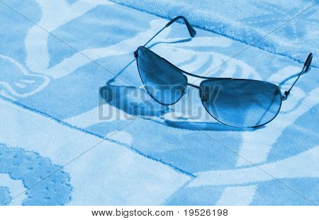 aviators on a towel - aqua tone