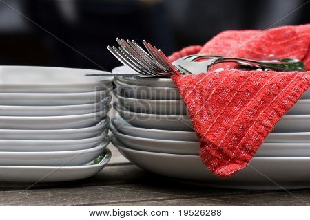 plates, cutlery, & napkins waiting to be set for mealtime