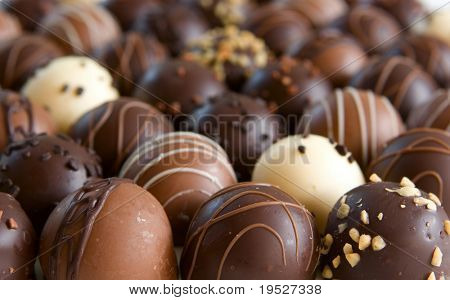 chocolate truffle candy background - focus only on front truffles