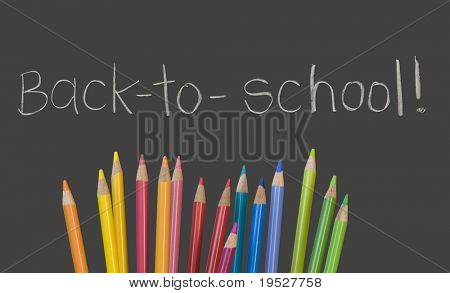 """back to school"" written on chalkboard with multicolored pencil crayons"