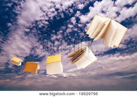 flock of books flying on blue sky background