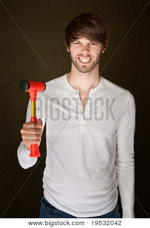 Man Holds Mallet