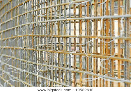 lattice of metal rebar rod reinforcement for concrete pouring at constructionsite