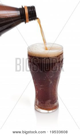 Glass Of Kvass With Flow From Bottle