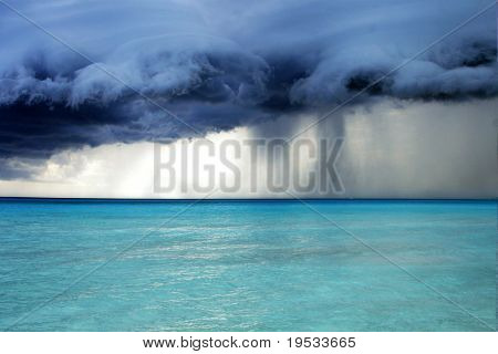 Stormy weather with rain on the beach. Before a powerful storm