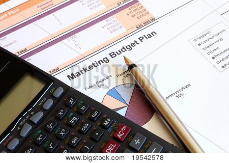 Charts and graphs of marketing budget plan with a calculator