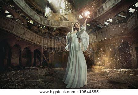 Beautiful angel among golden dust