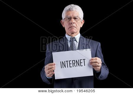 Senior businessman holding a paper with the Internet word (isolated on black)