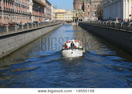 Tourictic boat on city channel. St.Petersburg, Russia
