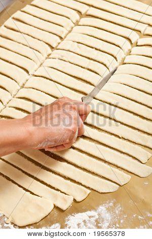 Hands Of A Woman Preparing Cookies