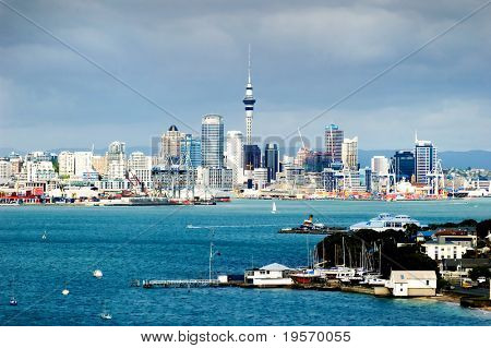The Auckland City Skyline, with dark brooding clouds in the background