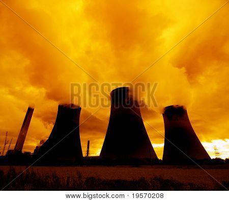 A red sunset looms over a nuclear power plant...