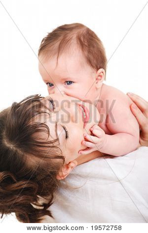 Baby kissing his happy mother
