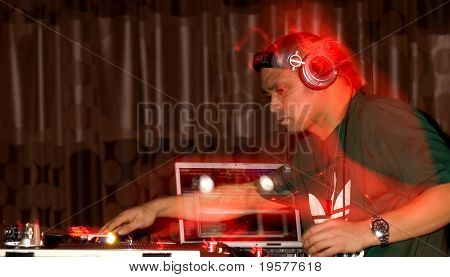 Dj in motion in nightclub