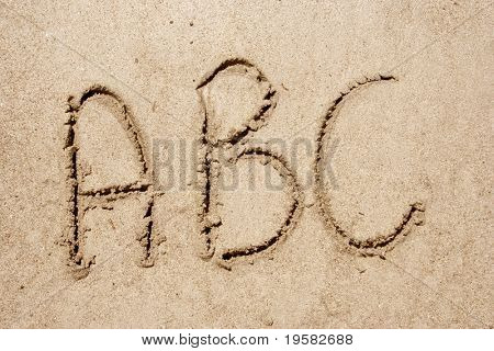 Alphabet letters ABC handwritten in sand ideal for font, nature or conceptual designs