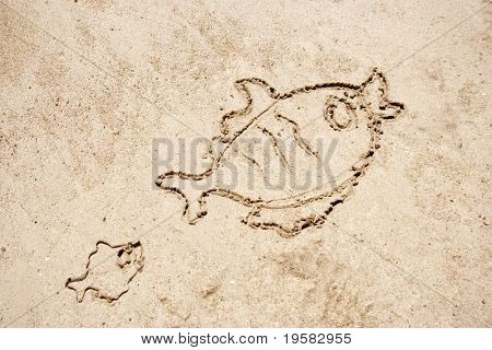 Two fishes drawn in sand for natural, symbol,tourism,fishing or conceptual designs