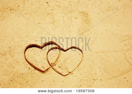 Heart shapes drawn in sand for natural, symbol,tourism,holiday or conceptual designs