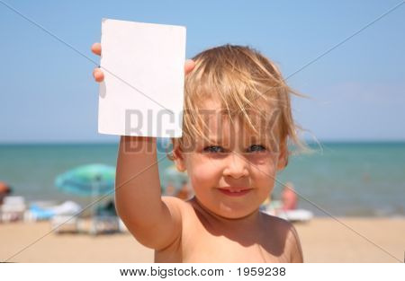 The Child Holds A Paper.