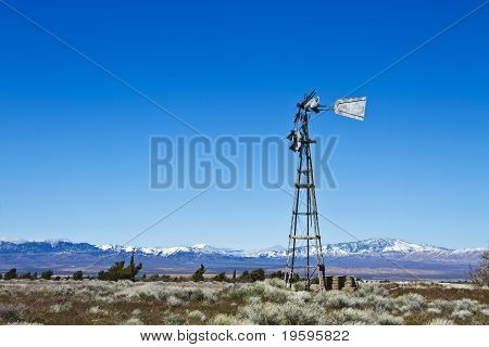 Broken Windmill On Deserted Farm
