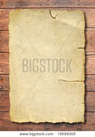Conceptual old paper over a grungy wood background