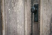 Rustic Vintage Door Knob On Antique Door Wood. Door Knob And Keyhole Made Of Brass On The Old Wooden poster