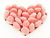 stock photo of jelly babies sugar  - Heart of jellybeans placed next to each other - JPG