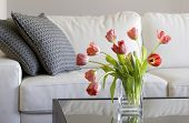 stock photo of flower vase  - vase of red tulips in modern white living room  - JPG