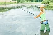 pic of fisherwomen  - woman fishing in pond - JPG