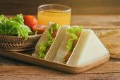 Piece Of Sandwich Ham Cheese With Lettuce And Tomato On Wood Plate. Homemade Sandwich Served With Or poster