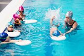 Swimming Class On Indoor Swimming Pool, Toned Image poster