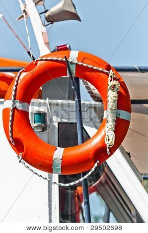 Red Bouy On A Boat Ready To Save Lives