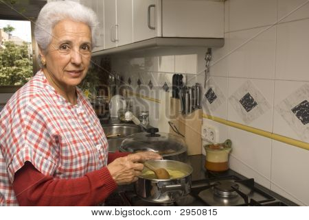 Senior Lady At Kitchen
