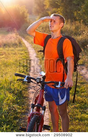 Man Cyclist Carefully Scrutinizes The Direction