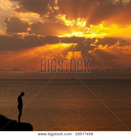 Silhouette Of A Man On A Cliff