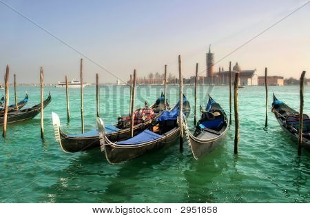 Gondolas on Grand Canal in front of San Giorgio Maggiore church.