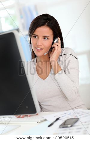 Woman in office having a video conference with business partners