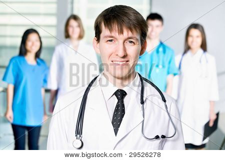Doctor standing in Front of her team in the hospital