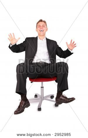 Laughing Young Person On Office Chair