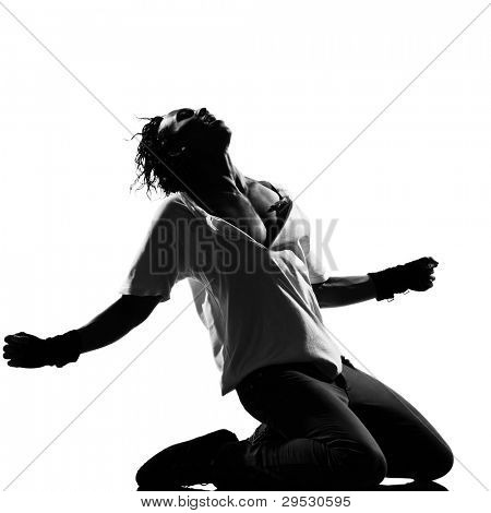 full length silhouette of a young man dancer dancing kneeling screaming funky hip hop r&b on  isolated  studio white background