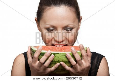 Closeup portrait of beautiful Asian woman eating watermelon in studio isolated on white background
