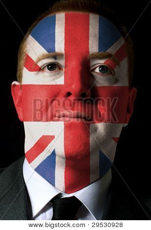 Face Of Serious Businessman Or Politician Painted In Colors Of United Kingdom Flag