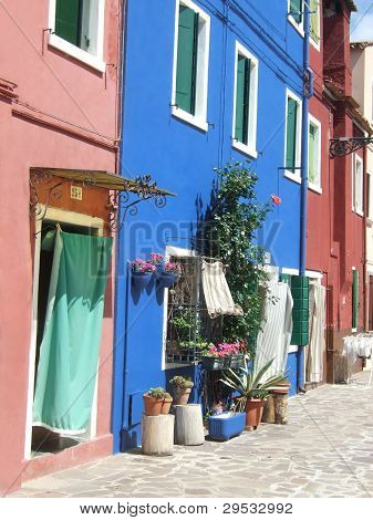 Brightly colored homes on Burano, the lace-making island off the coast of Venice, Italy