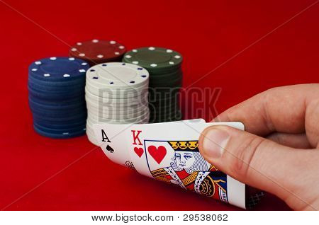 Ace Adn King High On Red Table And Chips