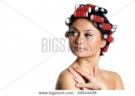 Hair curlers. A portrait of the young girl with hair curlers on a head