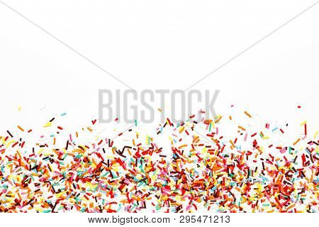 poster of Multicolored Sugar Sprinkle Dots, Decoration For Cake, Isolated On White. Birthday And Holiday Backg