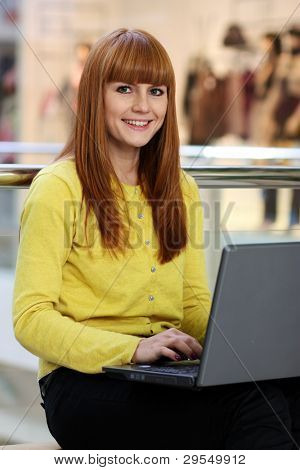 The young girl works behind a computer