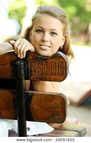 Portrait of the Russian girl on a background of a summer garden