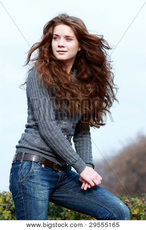 Beautiful brown-haired woman in autumnal park