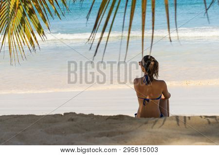 poster of Traveler Girl Relaxing On Tropical Beach. Young Girl Traveler Relaxing In Vacation. Traveler Relaxin