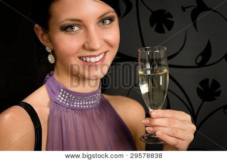 Woman party dress toasting champagne glass drink glamorous look camera